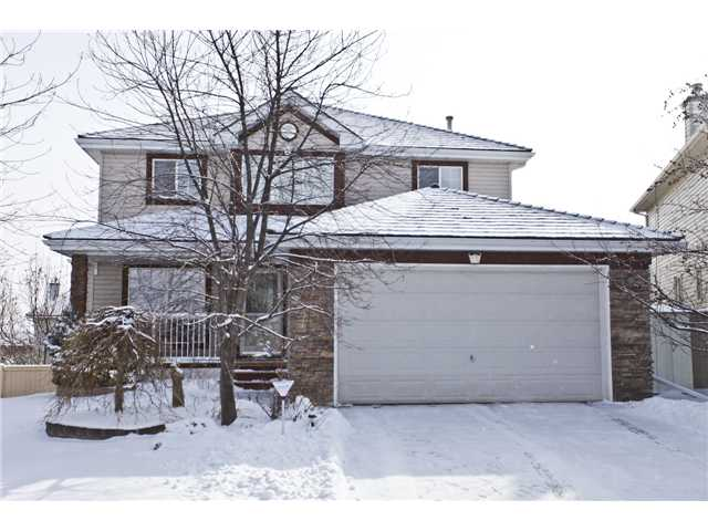 "Please click on ""VIEW MULTIMEDIA"" to view virtual tour. Beautiful, fully finished 2 storey WALKOUT on a super quiet street, 1 block from St. Sebastian Catholic School (K-6)! Great home for a large family & it is move in ready - features include: 4+1 bedrooms, 3.5 baths, large pie shaped yard with fantastic landscaping including U/G sprinklers & fire pit, open concept kitchen/large breakfast nook, formal dining room, 2 fireplaces, large wrap-around deck, hardwood floors, solid wood built-ins, insulated double garage, fully finished WALKOUT basement, large master en suite bath with double sinks/make-up counter & jetted tub (mountain views), 2 hot water tanks, central air, all new low-flush toilets and much more! Location is unbelievable - 1 block from K-6 Catholic school/playground, 5 blocks from lake entrance & all the fabulous Lake Chaparral amenities, 2 minute drive from shopping & the new ""Blue Devil"" golf course. For the big family, this home is exactly what you are looking for!"