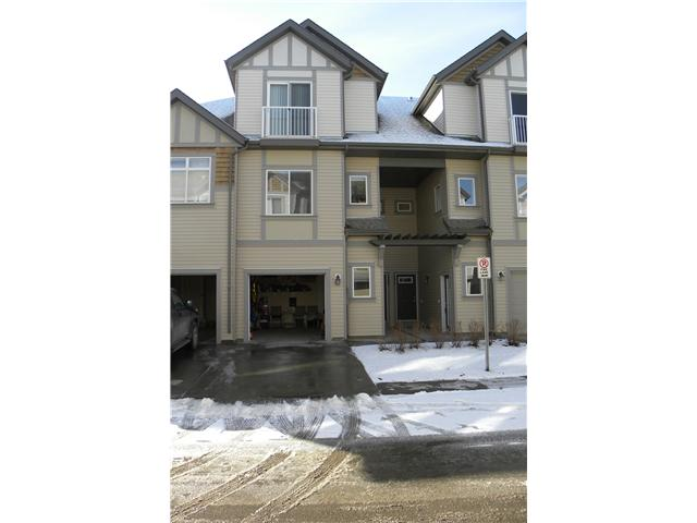 Prime location, SOUTH facing two bedroom + den townhouse, overlooking the GREEN area/Soccer field.   Enjoy easy living in this OPEN style, Sable built, trendy 2 storey townhouse. Modern, FUNTIONAL kitchen with full height cabinetry, with lots of counter/work area & oversized BREAKFAST BAR. 9 ft ceiling.  Attractive, easy care laminate flooring.   Flooded with lots of natural light with lots of windows. Two piece powder room, storage area on main. Upper level boasts two generous bedrooms,(walk-in closet), & 4 piece bathroom, Insuite laundry.  INFLOOR heating, ON DEMAND HOT WATER TANK.  Enjoy the green space from the large balcony. Single ATTACHED drywalled garage.   Located in beautiful Evanston. Well managed condo with low condo fees of $204.26 per month. Visitor parking. Total above grade living area based on CREB Rules.
