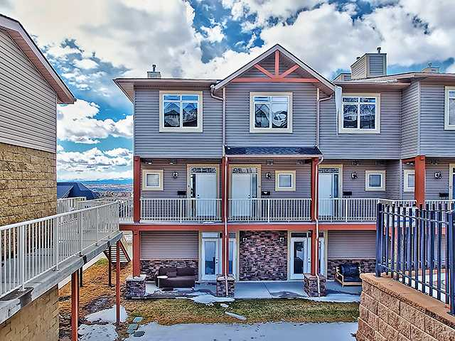 *Open House Sat, Ap 12, 1-3:00* This is the condo you have been waiting for in Rocky Ridge Ranch with a list of features that go on and on. This fantastic end unit boasts stunning Rocky Mountain views, and inside this unit everything is done for you. This condo features 2 underground parking stalls, a separate storage unit, a gym facility you will actually want to use, is walking distance to coffee shops, groceries, and the new Tuscany C-train station opening Fall 2014. The main floor has an open concept kitchen with stainless appliance package, opens up to the dining area and living room with beautiful hardwood floors, contemporary lighting, extra windows, private balcony, and is one of the largest units in the complex. Upstairs you will find in suite laundry, 2 bedrooms; with the Master suite showcasing a 3 piece ensuite, large windows giving you those amazing views, and a good sized second room. Condo fees include heat and water so you just pay electricity. Come take a look today!