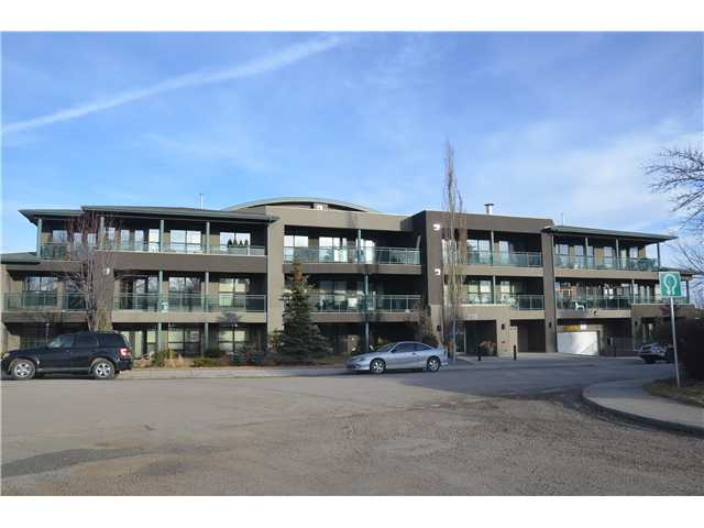 SUPERB executive style condo located in popular Parkhill/Stanley Park area. Absolutely IMMACULATE and a pleasure to view from the spacious tiled entryway through the open concept kitchen/great room. Wonderful maple cabinetry in the kitchen including a good sized island featuring granite countertops and funky lighting fixtures. The inviting great room boasts a brushed stainless surround gas fireplace and loads of windows letting in the natural lighting. The master suite offers a huge walk-in closet, brand new berber carpeting and a full 4 piece bath. Den is a good size with quality laminate floors. Another 3-piece and separate laundry room with storage complete this great condo. FRENCH DOORS off the great room lead to a good sized deck with gas line for your Bar-B-Que This building includes an exclusive exercise room and storage area for your bike. Great opportunity to live minutes to downtown, close to shopping and LRT public transportation.