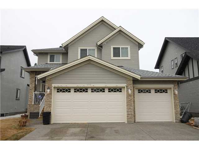 THE DETAILS & ATTENTION TO FINISHING ARE WHAT GIVE THIS 4 BEDROOM HOME A WOW FACTOR. THE TRIPLE ATTACHED GARAGE HAS ROOM TO STORE ALL YOUR TOYS & MORE.  The main floor plan is an open design with dark hardwood flooring; tile inset with mosaic design at the entry; double front doors & transom windows. The family room has a gas fireplace with full height stone face and custom cabinetry on either side.  The modern eat in kitchen with aqua glass mosaic backsplash & two tone cabinetry delights with ample counter space, a two drawer dishwasher, wall oven, cook top, professional hood fan, built in microwave & side by side fridge. Climb the staircase with inset lighting & metal spindles to the upper bedroom area.  The master retreat has large windows & five piece ensuite with his n hers sinks and tons of storage. Large kids bedrooms + The front bedroom could be easily be used as a bonus room. Must be seen to be appreciated.