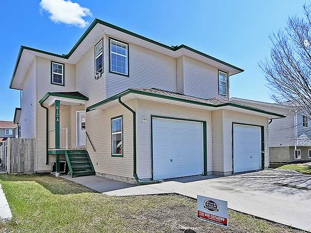 """Wonderful opportunity for first time home buyers or a great investment property. This comfortable 5 bedroom family home with many recent upgrades including: new roof, new eaves, new flooring on main level, fresh paint throughout and a new fully finished basement. The main floor boasts an open floor plan with kitchen, offset dining nook, living room and half bath with main floor laundry. Upstairs you will find a huge master bedroom with loads of storage, two more spacious bedrooms and a 4 pc main bath. The recently finished basement is fully developed with plush carpet, two more bedrooms and a office / den. The exterior of this home features a fenced  east facing backyard with alley access. Single attached garage is fully insulated,  drywalled and painted. Stop renting and pay yourself first! Call today to book your private showing and """"Start Packing""""!"""