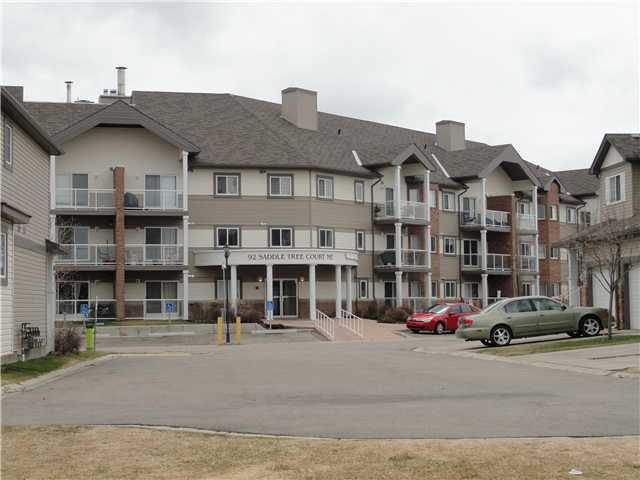 Fabulous 2 bedroom condo backing on the pond with gorgeous views. South backing with natural light all year long! This unit is in immaculate condition. Featuring tile flooring in the entry way, kitchen and bathroom. Laminate flooring in the living and dining areas and carpet in the bedrooms. Appliances are all stainless steel and replaced a mere 3 years ago. This development is only mins from the LRT and amenities such as grocery shopping, banks, Boston Pizza and The Genesis Centre. And, Calgary Transit bus service stops right outside of this professionally managed complex.