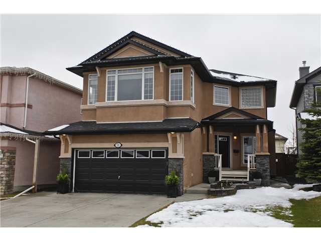 "* OPEN HOUSE Saturday 1:00pm-3:00pm * Click on ""VIEW MULTIMEDIA"" for Virtual Tour * Extremely well maintained, fully finished 2 storey home on a super quiet street in beautiful Lake Chaparral! Features include: heated main floor (rare), 9ft ceilings on main, 2 cozy fireplaces, huge bonus room, sunny southwest facing back yard, large 2-tier ""Trex"" deck with lights, U/G sprinklers, built-in cabinets, heated/finished garage with sink & man door, central vac with kick-plates, A/C, water softener, new 50 yr roof & hot water tank (2013), jetted tub, widened driveway, 2 concrete sidewalks - front to back, stucco exterior, developed basement & more! Location is unbeatable - 1 block from St. Sebastian School (K-6), 10 blocks from Chaparral School (K-5) & the lake entrance (this home has lake privileges), 2 minute drive to Blue Devil golf course & easy access to Macleod Trail/Ring Road/Deerfoot. The original owners have kept this home in BRAND NEW condition & it shows 10 out of 10 - you will not be disappointed!"