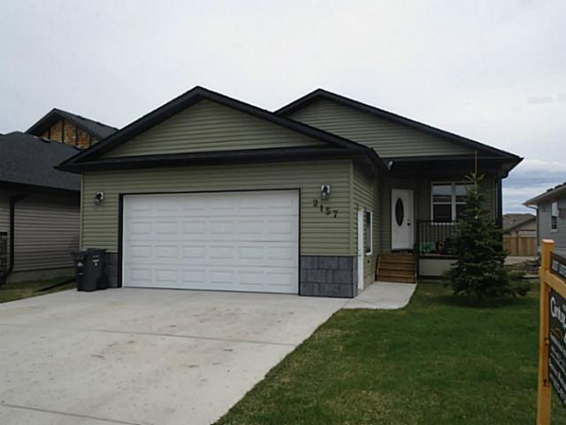 Super clean family home located in NW High River near water park. This functional home has a open floor plan with main floor laundry, den and vaulted ceilings. The kitchen has maple cabinets, granite counter-tops, island, corner pantry. Breakfast nook with door leading out to a south facing back covered deck. The large master bedroom has a walk-in closet, 5pc ensuite with his and her sinks, separate walk-in shower and bath tub. Additional bedroom is situated next to 4pc bath. The fully finished basement has in-floor heat, another bedroom, 4pc bath, and a huge family room. Double attached oversized garage. Call today to book your private showing.