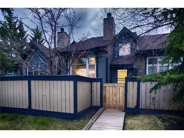 Welcome to this partially updated, 2 bedroom plus loft, 2.5 bathroom townhouse in Woodbine.  Hardwood throughout the main floor, finished basement, and double car garage make this place a perfect place to call home.  There is plenty of space for a family to call home with the loft area overlooking the living room and impressive fireplace mantle, some privacy with the master bedroom en suite, a finished basement that can be used for a theatre room, games room, or even a third bedroom for the growing family.  This 2 storey townhouse offers plenty of room to enjoy either relaxing in front of the fire while it crackles away or out on your private front deck, and if relaxing isn't your thing, you can put your office up in the loft area and work until your hearts content.  With the grocery store and mini mall just steps from your door and Fishcreek park nearby, this home has all you need.  Updates include some light fixtures, granite counters, hardwood, paint in the master bedroom, and backsplash in kitchen.