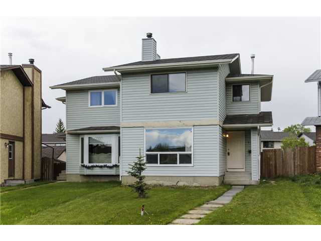 Great family home or investment property in Cedarbrae with NO CONDO FEES! This 2 storey home has an excellent location - very close to all schools, numerous parks close by, the community center within a few blocks and lots of shopping just next door! This home features: 3 good sized bedrooms including a very large master, spacious kitchen / dining area, family room with cozy wood burning fireplace, rear yard garden, 4-piece bathroom upstairs, 2-piece bathroom on the main, large single parking space in the back (with room to expand), brand new berber carpet, brand new counter tops, new taps/sinks, new tile backsplash, new electrical outlets & switches, new mirrors, new light fixtures, newer appliances, newer front window and all freshly painted. Neutral colors throughout the home.  Quick possession - don't miss this one!