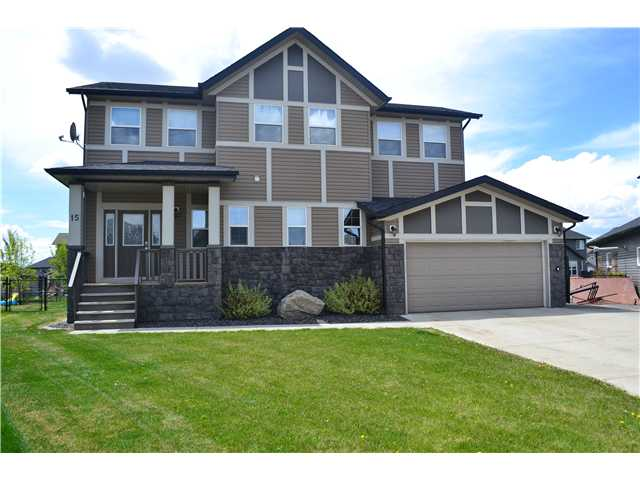 Welcome home to the Beautiful BOULDER CREEK golf community in Langdon. This Fantastic 2 storey home features over 2,900 sq ft of TOTAL DEVELOPED living space! Located on a LARGE PIE LOT backing onto a GREENSPACE AND WALKING PATH in a QUIET CUL-DE-SAC ! WIDE OPEN PLAN includes OVERSIZED FOYER, 3 Spacious Bedrooms, 4 Bathrooms. FORMAL DINING ROOM and GORGEOUS HARDWOOD FLOORING. The KITCHEN has UPGRADED APPLIANCES, GORGEOUS ESPRESSO CUPBOARDS with TONS of COUNTERSPACE & STORAGE. KING SIZED MASTER SUITE with 5 pc Ensuite with a MOUNTAIN VIEW. BRIGHT BONUS ROOM has LARGE windows to capture the sunrise and sunset. Laundry conveniently located on upper floor. LARGE RECREATION ROOM has remote DROP DOWN projector screen & WET BAR. Lower level also has an AMAZING BATHROOM with a TWO PERSON STEAM SHOWER(complete with built-in tunes too!) Great Workout area completes the lower level. BEAUTIFULLY Landscaped with IN-GROUND SPRINKLERS, CONCRETE CURBED FLOWER BEDS, PERENNIALS, GARDEN SHED, FIREPIT ,DOG RUN