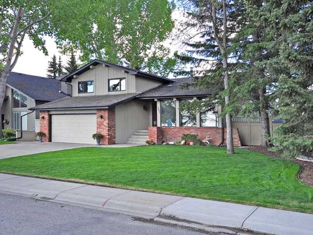 New shingles, stunning renovations & located across from South Glenmore Park. There are fabulous views of both downtown & the park. Come out & chat with the neighbors, they love it here & very few homes come on the market on this street. Many great school options in the area, including the Gifted Program (GATE), Spanish Bilingual & Science Program. Entering you will feel right at home. The soaring ceilings & the newer hardwood immediately gives a feeling of warmth. The dining room is perfect for entertaining, & you will want to entertain. The remodeled kitchen features a clever layout, raised breakfast bar & Granite. The family room has stunning grand patio doors leading out the beautifully landscaped south yard. The 2 tiered deck, stone patio & hot tub all create an oasis in any season. There is even a zipline. The bathroom, 4th bedroom & laundry area compete this level. Upstairs you will find a generous master with walk-in closet. Notice the amazing doors & hardware, 220 in garage & newer windows.