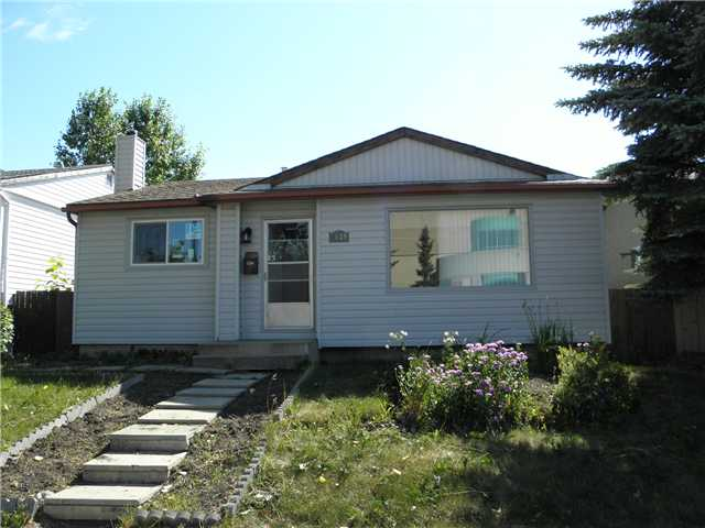 Wow! This bright bungalow boasts new  windows, roof, furnace and hot water tank! Newer siding and insulation (helps cut down bills) flooring and bright open plan. Basement is finished with a separate entrance, full bathroom and bedroom. Lots of potential for additional room and kitchen. Large deck on the back with oversized garage (24x26) with RV parking. Excellent opportunity, must be seen! Call realtor today.