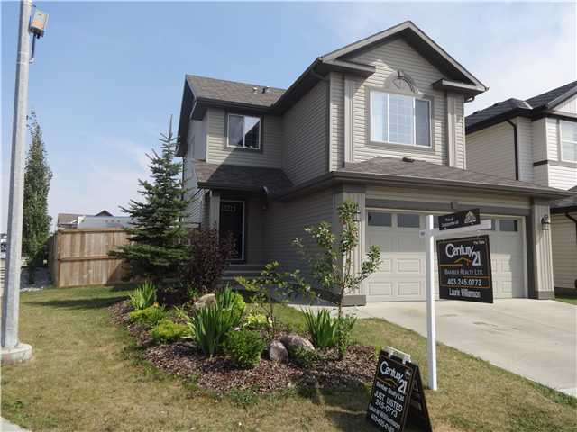 Home is what you will feel as soon as you walk in the door. Over 1600 sq ft of comfort and relaxation. This Beattie built home is offering loads of extras, inside and out. The large corner lot has a 300 sq ft, deck with a built in pergola, mature trees for privacy and still plenty of room for garden and RV parking. A great room made for  entertaining, beautiful maple cabinets, large pantry, extra windows, hardwood floor and 9 ft ceiling. Decorated with wainscoting, crown molding, great colors and a built-in niche. The cozy corner fireplace is just a bonus. Upstairs includes 3 good size bedrooms again with extra windows for lots of natural light. Retreat to the owners suite to get away and enjoy at the end of the day...soaker tub, separate shower and walk-in closet. A bonus room featuring the 2nd fireplace vaulted ceiling & steps away from the little ones. The basement has roughed-in electrical, plumbing & framed to get you started on the next level. Another 50 amp panel is in the double attached garage.