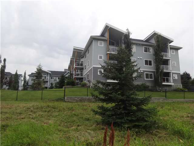 Price Reduced on this bright beautiful 2 bedroom end unit is located in the Bay Club Complex & overlooks Chestermere Lake.  Easy sharing for 2 as this unit comes with 2 parking stalls (1 heated underground & 1 surface stall), 2 bedrooms, both with ensuites-1 with a 4 pc & the other 3 pc.  This unit is very bright with the benefit of added windows because it is an end unit.  It also has in-suite laundry & titled storage in underground parking.  This beauty has all of this plus granite counter tops, maple cabinets, tile back splash, ceramic tile floors, 1 piece fibereglass tub & shower & 5' shower with glass doors.  Also, the natural gas BBQ & the electric fireplace will both be staying.  Great location being close to all amenities, the lake, pathways along the lake, shopping, restaurants, etc. and an easy commute to Calgary!!!
