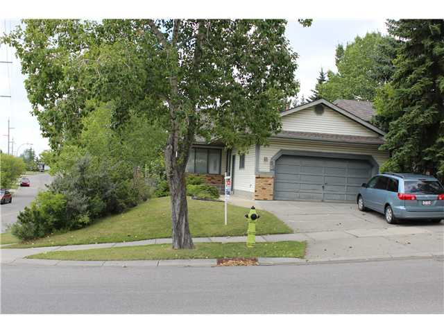 Rare find in Hawkwood! Large 1,259.39 sq ft, 5 bedrooms + a den, 2.5 baths bungalow w/ a double attached garage & fully finished walkout basement to a west facing backyard with shrubs & fruit trees. Recent updates include hardwood floors in living room/dining room, whole basement re-painted, newer deck & some windows replaced. The main floor has 3 bedrooms (the master bedroom w/ a full en-suite), 2 additional rooms, the main bath, formal dining room w/ partial view of the mountains & a spacious kitchen w/ a nook which has a door to the deck at the rear. The finished walkout basement could be easily suited (illegal) to help w/ mortgage payments & it features a massive family room w/ built-ins & wood burning fireplace, 2 bedrooms, an office space, the furnace room & a den/office space. This one won't last long!