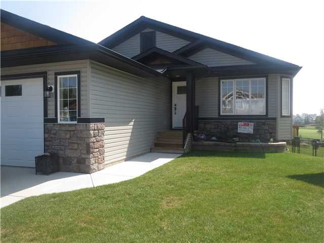 "Beautiful 3 +2 bedroom bungalow in the NW. Spacious entry, opens up to open kitchen/living/dining area with vaulted ceilings (skylights bringing in even more natural lighting) and corner gas fireplace! Gorgeous maple cabinetry, stainless appliances, built in desk and corner pantry. Deck off dining area perfect for summer BBQ's and enjoy the views of the golf course! Master bedroom is a great size and has a beautiful ensuite with separate tub/shower, and complete with walk-in closet! Main floor laundry, two more bedrooms and four piece bath complete them main! The walkout basement features a large family area and rec space,two additional bedrooms a third four piece bath, and storage space! Central air and in floor heating are just a couple of upgrades this home has to offer along with plenty of parking and  nice size double attached garage! Don't miss out on this rare find, call today and ""Start Packing""! Adjoining lot is also for sale please ask your agent for details or view MLS C3631839!"