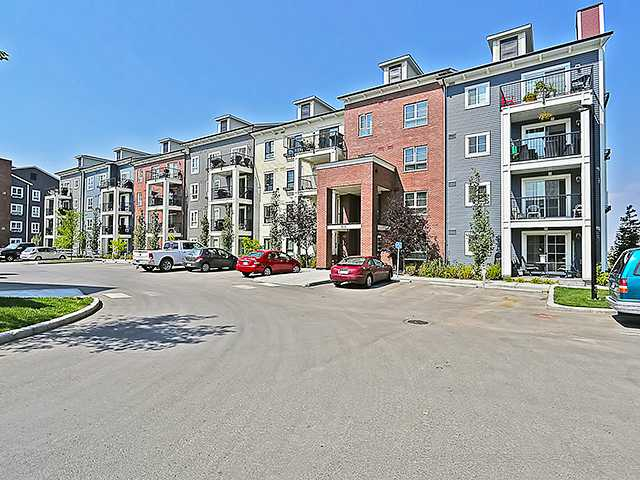 Gorgeous two-bedroom condo, located in  in Copperfield! Showcasing the pride of ownership, this third-floor unit offers an open concept layout, with dark engineered hardwood floors flowing through a living room that opens out to a covered balcony with unobstructed views and a gas jet for your barbecue! The kitchen features stainless steel appliances, granite counter tops, a modern glass & stainless steel mosaic backsplash, and plenty of cabinetry that has been upgraded as well as all light fixtures. Both bedrooms are of a good size, with the master boasting a walk-through closet to a private ensuite and the second bedroom offering access to the other full bath. This unit offers an underground heated parking space, is air-conditioned, and parks & convenience stores within walking distance! Call to schedule your private viewing today!