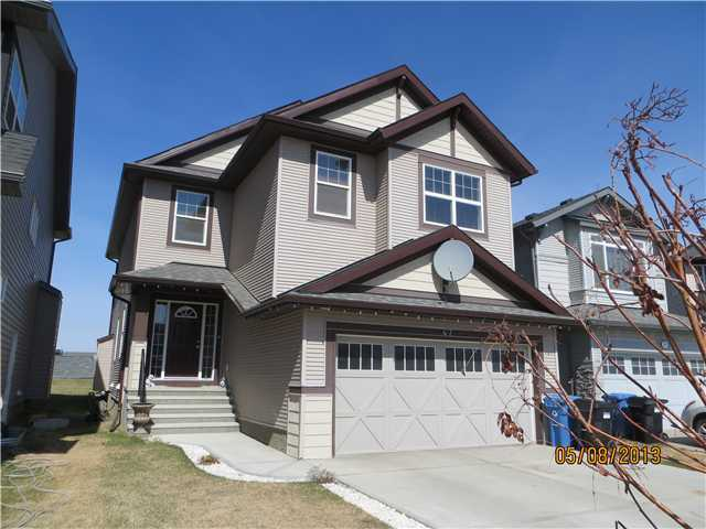 Gorgeous 2448 SF, 2 storey 'ARLINGTON' by Morrison Homes, Located popular Skyview Ranch. NW facing backyard, comes w/huge deck, gazebo & fire pit. Ceramic & oak hardwood flooring, rounded corners (throughout the house), 9'ceilings throughout main, 2pc bath, den/dining room, spacious family room w/oak mantle & tile facing gas fireplace. Beautiful large kitchen w/massive island & eating bar, brand new built-in microwave oven. Gas Stove, built-in dishwasher, & Large breakfast nook Upper floor has four generous sized bedrooms; large master w/5pc luxurious ensuite bath, spacious walk-in closet, 2nd floor laundry room, & large bonus room. Fully Finished basement is ready for your enjoyment complete with a large bedroom with walk in closet, full bath and large living room. High efficiency furnace & a 45 gal hot water tank. Tons of windows make this a bright & cheery place for a family to come home to. It is competitively priced to sell, so be sure not to miss this one!!