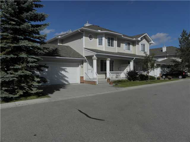 """Private end unit, adult 45+ complex in """"The Homesteads"""". Great room with cozy gas fireplace, separate dining area & plenty of room for furniture arrangement. Functional kitchen with walk-in pantry, door to large private west facing patio with mature trees & landscaping (great for BBQ & entertaining).  The upper level boasts two generous bedrooms, each with its own ensuite & walk-in closets.  One is especially excellent for a home office or someone enjoys lots of space.  Upper level laundry.  Fully developed basement with a spacious family room, 3 piece bathroom & den & 2nd gas fireplace. Loads of natural light throughout. Double attached garage.  Enjoy sipping your morning coffee on the front veranda or in the patio! Rarely do units come up in this complex. Condo fee of $390. Include snow removal/lawn care, exterior maintenance, water & sewer. Prime location, just mins to West Hills Shopping, Westside Rec, LRT and  a quick trip to Downtown. Excellent plan & layout."""