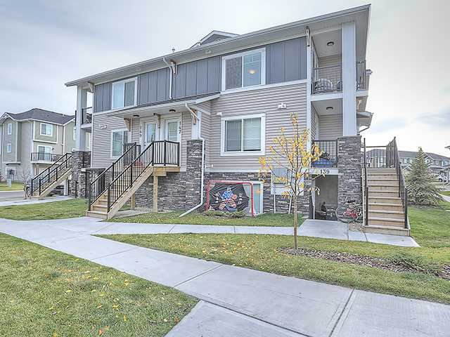 Come out and have a look at this fantastic 2 bedroom condo located in desirable Chestermere Station. This condo is just steps away from all of the Shopping and Amenities you could want, including the Lake. This 3rd floor, open concept, corner unit is ready to move in or alternatively to keep as a fully managed investment property. Just built in 2012 this condo shows very well in person and has been well maintained. With neutral paint colours, in suite laundry with extra room for storage, an assigned parking stall, low condo fees of under 135 dollars a month (each unit has their own furnace and hot water tank), this is the best value in the town of Chestermere at this time.  This complex allows pets and you may have up to 2 cats or 2 dogs or 1 of each, birds in a cage and fish in a tank are just fine too. Call your favourite Realtor and come look today!