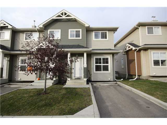 ABSOLUTELY A GORGEOUS PLACE!!!. PRIDE OF OWNERSHIP!!!. THIS END UNIT IS COMPLETE WITH 3 BEDROOMS 2 AND A HALF BATHROOMS (MASTER HAS 3PIECE ENSUITE) NICE NEUTRAL DECOR. ELEVATION IS HIGHER WHICH LEADS TO A RAISED BALCONY AND SUNSHINE BASMENT-THE WINDOW IS BIGGER. MAIN FLOOR HAS 9 FT CEILINGS AND AN OPEN CONCEPT FLOOR PLAN. BEAUTIFUL KITCHEN with BREAKFAST BAR, MODERN LIGHTS, BLACK APPLIANCES, TILED BACK SPLASH. SEPARATE DINING AREA opens to a LARGE DECK for summer BBQ's. HUGE GUEST BATH on main floor.  Upper floor has 3 BEDROOMS, MASTER SUITE with A LUXURIOUS ENSUITE BATH  (HUGE SHOWER). 2nd and 3rd Bedrooms & a BEAUTIFUL MAIN BATH with TILE-SURROUNDED BATH TUB UNIT.BASEMENT HAS ROUGH IN PLUMBING AND IS WAITING FOR YOUR PERSONAL TOUCHES. CONVENIENT PARKING right at the front door, LOW CONDO FEE ($145/M).  GREAT LOCATION, WALKING DISTANCE TO GENESIS CENTER, SHOPS,LRT SCHOOLS, PLAYGROUND, PARK..A GREAT HOME!!