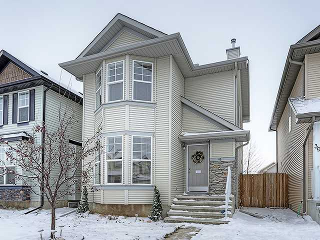 Beautiful Cranston family home, situated on a family-friendly street in this great community! The main level offers a living room with hard wood floors, a big bay window, and a tiled gas fireplace with a mantle & built-in entertainment center. The dining area is spacious, and is open to a kitchen boasting low-maintenance floors, rich cabinetry, stainless steel appliances, a pantry, and a raised breakfast bar. It also offers access to the large deck, fenced yard, and plenty of room for parking, RV storage, or a double detached garage! The upper level houses three bedrooms, including a master, light & bright, with a large bay window showcasing mountain views, and a walk-in closet. The basement is unspoiled, awaiting a creative touch. Call to arrange a viewing & see yourself living here today!