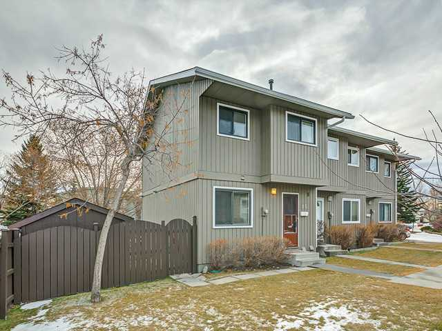 ATTENTION: FIRST TIME BUYERS & INVESTORS! Immaculate two story, 3 BEDROOM townhouse on a large fenced lot in pet friendly complex. Enjoy your morning coffee on the spacious east facing deck ,mature trees and a huge wooden garden shed (8ft x8ft) for extra storage. Inside you will find a large open kitchen with eating area, living room with wood-burning fireplace, 3 bedrooms upstairs,1.5 baths and a fully developed basement. This is a great property for a reasonable price in the very conveniently located community of Ranchlands!  Close to schools, parks, Crowfoot shopping center, U. of C. and quick driving access to major routes. Low condo fees in a well managed complex.  Book your viewing today!