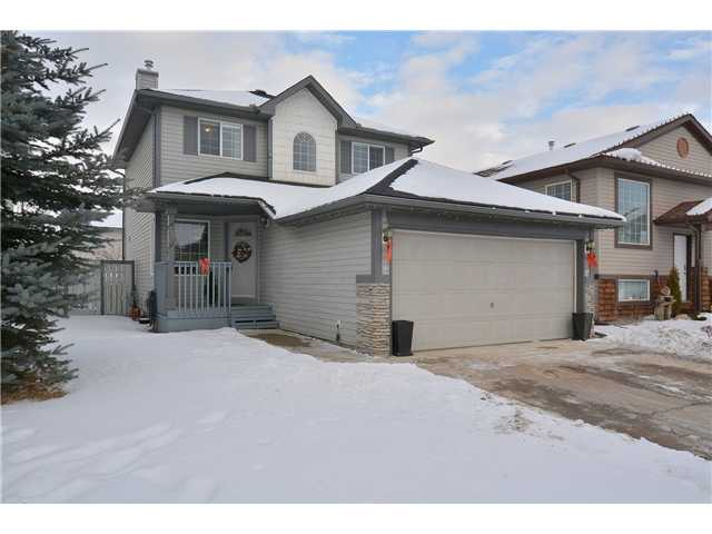 Beautiful Family Home with a Fully Finished Basement close to schools, parks, shopping and the Okotoks Health Centre. You will love the main floor plan with a front dining room; large bright kitchen with walk-in pantry & plenty of counter/cupboard space with island eating bar; the family room is open to the kitchen with a warm gas fireplace for those cold winter evenings. There is also a 2 piece bath & laundry. Upstairs find 2 generous kids bedrooms & The master retreat. The master has a walk-in closet with custom shelving & 4 piece bath with jetted tub. The fully finished basement has a games room, recreation room and den that could be converted to a 4th bedroom. The large backyard has an apple tree and aggregate concrete patio with room to play. The garage is like a workshop with 240 volt panel and painted floor. Call today for your private showing!