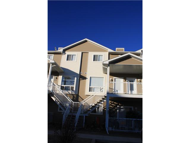 Don't miss a great opportunity to own this bright and spacious townhouse at Sunrise Terrace Villas in High River.  This unit features 3 bedrooms and 1.5 baths with granite counter tops throughout, ample counter space in the kitchen and includes 2 assigned parking stalls and a separate storage room on the balcony.  The West facing balcony provides beautiful mountain views and plenty of sunshine and the complex has a playground area for the kids.  Call now to book a showing!