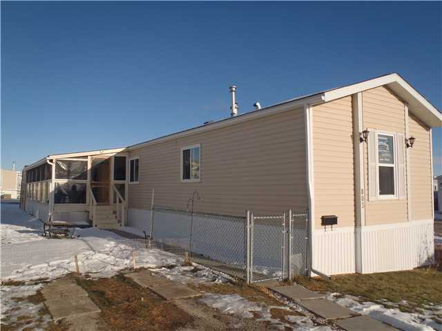 ***  PRICE REDUCED!!! SELLER MOTIVATED!!!  *** Come and check out this lovely bright open 1184 sq ft. 3 bedroom, 2 bathroom home.  This home has many special features which include the new 10' x 32' closed in deck, laminate and lino flooring, new skirting, insulation and electric heat tapes, large storage shed, fenced yard, new sinks, toilets and faucets in both bathrooms and the list goes on!!! The large living room has a corner electric fireplace and vaulted ceilings. The bright kitchen has newer appliances and a corner pantry. This spacious home is located on the BIGGEST LOT in Chateau Estates.  The community centre boasts a hot tub, sauna, games room and a gym for residents enjoyment and a playground for the kids.