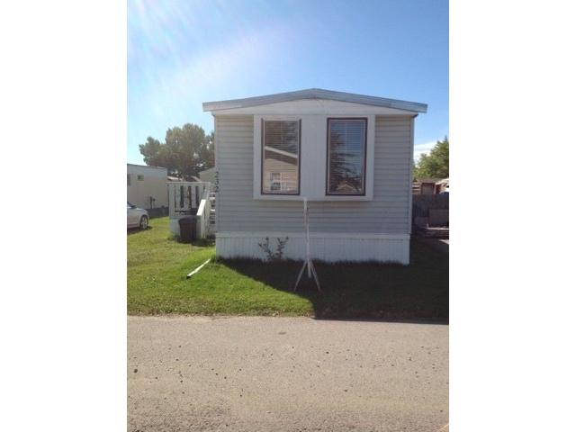 """GOOD TO GO! OWNER SAYS """"SELL"""" NICE CONDITION 2 BEDROOM CONVERSION. NEWER LAMINATE FLOORING AND METAL CLAD ROOF. GENEROUS DECK AND PARKING FOR 2 VEHICLES. REAL CLEAN UNIT AND OWNER CAN BE OUT IN A HURRY!"""