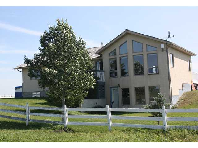 Country living, mountain views, and peace and quiet are less than 25 minutes from Calgary.  This acreage has so many possibilities.  With over 8 acres, this gem is currently set up as a horse training centre.  The barn has 7 inside stalls, two tie stalls and 4 outside. If you don't have horses, this can be a great revenue source to board horses or rent out the space.  You can also remove the inside stalls and convert it into garage or a work shop. The choice is yours. There is a double garage, several sheds, and plenty of space with 8.23 acres to do as you please.  The walkout bungalow has incredible mountain views from the large living room windows. The basement is a fully finished walkout with an additional bedroom, a hobby room, a pool table, theatre or exercize room.  The possibilities are endless and at this price so close to Calgary, this gem is sure to go quickly.  Call today for your private viewing or contact your favourite real estate agent.