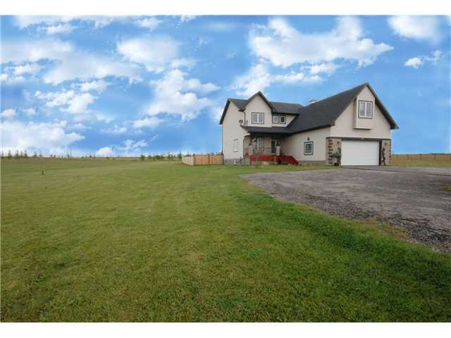 How often do you wish you had MORE SPACE from neighbours & MOUNTAIN VIEWS but you didn't want to compromise on the QUALITY OF A HOME IN TOWN & all town living has to offer?  Just moments east of Okotoks, with easy access to the Highways, this BEAUTIFUL 2003 built, 2,700+ square foot two storey home, gives you everything you are looking for.  Work at home or need somewhere for the kids to study? Check out the MASSIVE DEN with BUILT IN desks & storage.  Like to cook?  The KITCHEN is so SPACIOUS, with masses of cabinetry.  The FAMILY ROOM is cosy & warm with a gas fireplace.  Two decks & a patio within a fenced inner yard, give seclusion & a safe space for your children & pets.  Upstairs, the MASTER gives even better MOUNTAIN VIEWS & a 4 piece ensuite while the other 3 bedrooms are all good sizes.  The BONUS ROOM is quite ENORMOUS as it runs the full length of the spacious garage!  It's on the school bus route too, so roads are cleared!  If you're going to buy in town, STOP! YOU MUST COME & SEE.