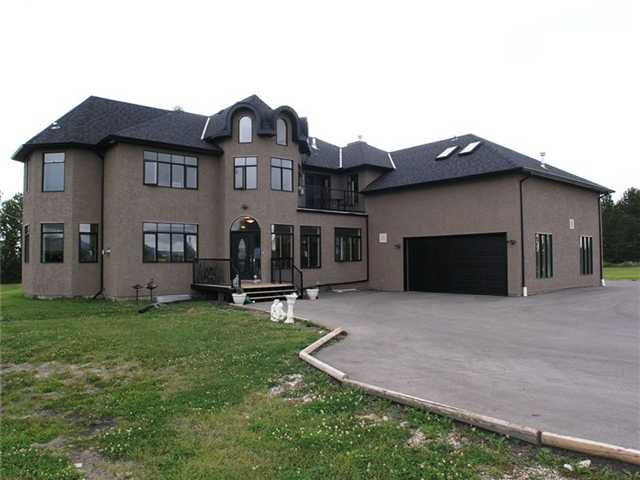 """* CLICK ON """"VIEW MULTIMEDIA"""" TO VIEW VIRTUAL TOUR ** Two homes for the price of one! Included in the list price is a massive 4436 sq.ft. (plus developed bsmt) executive 2 storey home AND a 1200 sq. ft. pool house, all located in South Springbank on 9.98 acres! This custom built home features: 7 bedrooms (5+2), 5 bathrooms (4+1), 5 fireplaces, a gourmet chef's kitchen with granite & commercial stainless steel appliances, 3 wet bars (one on each level), 3 upper level balconies, a 36x16 swimming pool, hot tub, colossal deck for entertaining complete with wood burning pizza oven, wet bar, side x side beverage fridge & built in BBQ/grill set up. The fully developed basement includes: huge wet bar, sauna, massive steam room, large rec room, lots of storage and 2 huge bedrooms! The pool house includes: 3 bedrooms, bathroom, kitchen, living area, dining area and partially developed basement. County by-laws allow for 2 horses so bring Bullseye and Seabiscuit!"""