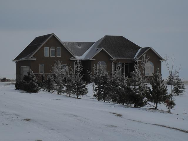 MOUNTAIN VIEW, CUSTOM BUILT LUXURY HOME, 15 MINUTES TO NEW SOUTH CALGARY HOSPITAL!! Welcome home to this gorgeous immaculate kept home that would suit even the most discriminating buyer! With OVER 4300 sq feet of DEVELOPED living space, this home has been crafted to suit a variety of lifestyles! Perfect for extended families featuring 5 bedrooms and 6 bathrooms!(3 full en suites) The Beautiful gourmet kitchen has top of the line maple cabinetry along with granite counter tops, loads of workspace & formal dining room. Your sure to love the wide open great room along  the huge master bedroom complete with a very large walkin closet and  5 pc en suite. The beautiful finishing continues to flow with maple thru out the professionally developed lower level with 9 ft ceilings and tons space. There are many options in the bonus room above the garage from a home office, teen suite, playroom, mother in law suite etc..  The 25 acres will let you enjoy the freedom to pretty much the hobby of your choice!