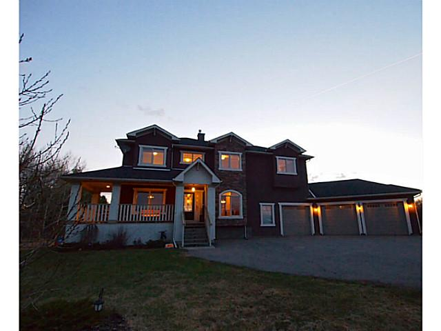 UNBELIEVABLE VALUE! Brilliant Sunsets & View Of The Majestic Rockies From This Fantastic Custom Family Home On Private 2 Acre Parcel Only Minutes To Shopping & Schools! 2 Storey With A/C, Fully Developed Walk Out Basement, Over-Sized Triple Car Garage, Hot Tub & Extensive Upgrades Throughout. Formal Dining Room; Den/Office; Gourmet Kitchen W/Center Island, Granite Counters, Stainless Steel Appliances Open To Large Family Room With Wood Burning Fireplace & Built Ins. Breakfast Nook Opens To Large West Facing Deck Where You Can Enjoy The Expansive Views. Upstairs There Is A Large Master Retreat With Sitting Area & 5 Piece Ensuite With Jetted Tub, Steam Shower & Walk In Closet. 2 More Bedrooms, Laundry, 4 Piece Bath & Media Room With Gas Fireplace. Entertain In The Fully Developed Walk Out Basement Featuring A Games Area, Fitness Room, 4th Bedroom & a 2 Piece Bath, Bose Speakers In Ceiling & Access To The Covered Composite Patio With Built In Heat Lamp & Luxurious Hot Tub.