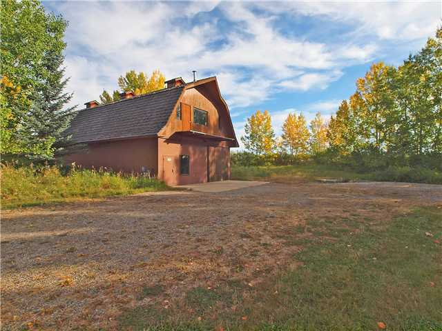 """""""You Don't Want Miss Out On This"""" Beautiful Mountain View 2 Acre Parcel located in North Springbank. Backing Onto a Ravine, the Parcel comes with a 30' x 60' Hooped Roof Barn/Shop/Warehouse/Garage that Could Easily Be Converted to a Residence, Drilled Well, Septic System, Natural Gas and comes complete with a Second Storey that has 2 Washrooms, Office and Large 30' x 45' Open Area for Future Development. The Lot is Surrounded by Trees and Provides for that Perfect Private Setting on which to Build. The location is close to Golfing, the Soon to Be Bingham Shopping Centre and Only Minutes to Downtown Calgary. Do not Hesitate, Call Me Today to View this Unique Opportunity!"""