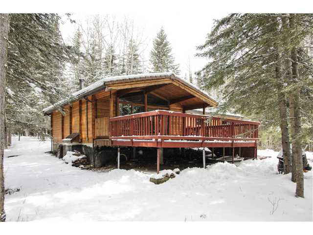 Excellent opportunity to make this property your dream homestead!  Very cozy cedar log bungalow with over-sized double detached garage on 7 acres just outside of Bragg Creek!  Features include: 3 bedrooms above grade, 2-piece en suite bath, 4-piece bath on main, vaulted ceilings in a large family room, wood burning fireplace, large deck with covered and uncovered areas, rear deck, tons of trees, brand new eaves troughs, hardwood flooring, over-sized double garage with concrete floor and much more!  Location is perfect - 1 minute outside of town, a 3-iron away from Wintergreen Golf Course and close, but not to close, to the Elbow River!  Great property - loads of potential!