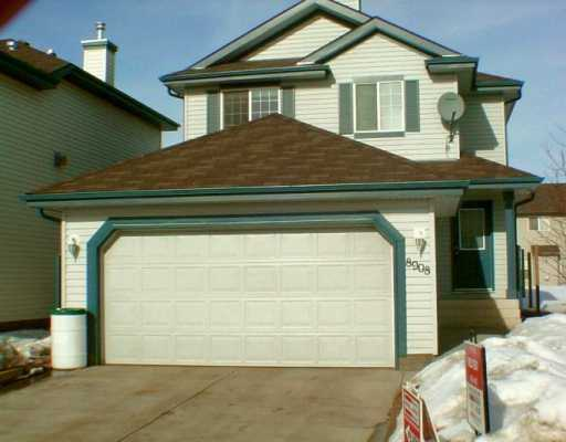 This home is located in Ellerslie Crossing, just minutes away from shopping, parks, transit and Whitemud Dr. Offering 1454 Sqft. this 2 storey has three bedrooms, a main floor den, 2 1/2 bathrooms, a double attached garage and roughed in networking for a future home entertainment center. Additional features include soft corners throughout, a gas fireplace and an extended new home warranty, expires Nov. 2012. The kitchen has plenty of counter space, pantry, a built in dishwasher and built in microwave. The eating area is spacious with sliding patio doors to the backyard. The master bedroom has a large walk in closet and a 4-peice ensuite. The other 2 bedrooms are spacious with close proximity to the upper level bathroom. The home was built in 2002 and is in mint condition. The landscaping is completed with a rock garden in the frontyard and a backyard fence has been statred (posts have been grounded ). The basement is full and is roughed in for plumping.