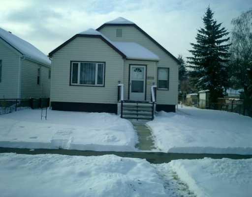 Completely renovated, new plumbing, electrical, furnace, insulation, bathroom, kitchen, all new windows in this spacious well located bungalow situated on a lot and half. Yard features include firepit, many fruit trees and berry shrubs, oversized double garage. Unspoiled basement with 2 piece bath. A pleasure to view.