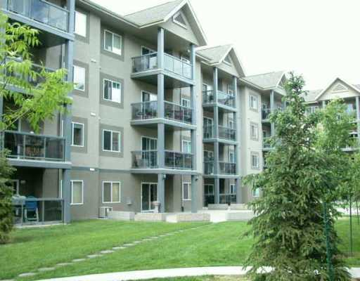This spacious 1110 sqft, 2nd floor apartment style condo located in prestigious Grande Lewis Estates surrounded by Lewis Estates Golf Course. Offers 2 bedrms, 2 bathrooms an island kitchen, living room, dining area, 1 underground heated parking with an extra storage area as well as one energized outdoor parking stall very close to the main entrance. Additional features and upgrades include trendy paint colors throughout, upgraded maple cabinetry and upgraded appliances, pewter fixtures, a gas corner fireplace and central air conditioning. The living room is spacious with sliding patio doors to a large balcony that has natural gas hook up for the BBQ. The balcony view is SW and over looks a putting green and the 17th hole of the Lewis Estates Golf Course. The MB faces SW as well and has his and her closets with a large 3 piece ensuite. The 2nd bedroom faces SW and is generous in size and features decorative lighting and sliding closet doors. Completing are in suite laundry, games and gym amenities.