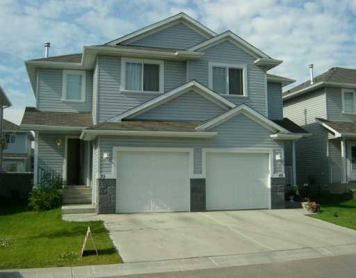 This 3 bedroom half duplex is located in Larkspur. Just minutes from schools, parks, shopping, transit and the Whitemud. Offering over 1270 sqft of living space with a full unspoiled basement. The upper level to this 2 storey offers 3 larger than average bedrooms with a walk in closet in the master and 4 piece bathroom. The main floor is open concept with a corner fire place in the living room, 2 piece bathroom and access to the single attached garage. The eating area features sliding patio doors to the fenced back yard. The back yard has a deck and a stone patio for BBQ and entertainment. Very trendy with neutral colors and funky fixtures throughout. The flooring on the main floor is upgraded to light oak laminate with vinyl in the kitchen and bathrooms. Flooring on the upper level is plush carpet. Condo fees are very low at $55.00 a month.