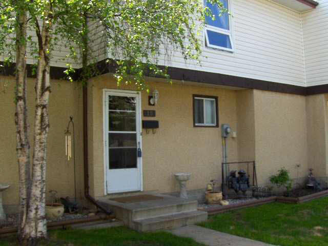 Beautifully upgraded townhome in Morinville, just minutes North of St. Albert. This home is done in earth tone colors and offering 3+1 bedrooms, 2 baths, fireplace and all laminate on the main and upper floors. Home has newer windows, doors, furnace (2008) and hot water tank (2002). Basement is finished with bedroom, laundry room and storage. Beautiful, fenced south facing patio with newer sod. Personal parking stall is close to your unit. Affordable, upgraded and ready to go!