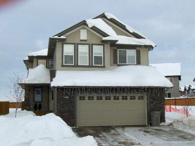 "Gorgeous 2007 Two Storey in quiet cul-de-sac on a pie lot, boasting over 2,000 ft2 above grade with 3+1 bedrooms, 4 baths, main floor laundry/mud room, f/f basement and insulated 24'x24' double garage. Main and upper floors are flooded with natural light, and the floorplan is open and intelligent. Quality kitchen has walk-in pantry, huge island, mocha cabinets, dark granite counters, gas stove and quality finishings. The Living area is large with towering windows and a gas fireplace....rich walnut hardwood and slate tile cover the main floor. Upstairs are 3 large bedrooms, a den w/french doors and a 4 pce. bathroom. The Master is spacious with large walk-in closet and a ""spa-like"" 4 pce. ensuite complete with soaker tub. Basement is finished with a 4th bedroom, 4 pce. bath with heated floor, rec room with gas fireplace and a ""state-of-the-art"" media room with black ceiling tiles, built-in shelves and a large screen w/ projector for movies and video games. Life is good...."