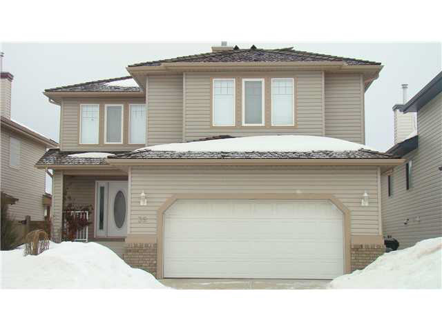 This fully finished 2200+s.f, 3+1 bedroom 2 storey features hardwood throughout the main floor, a Peninsula style kitchen with nook and stainless steel appliances,dining room,main floor laundry, Great room with gas fireplace, built in shelves, and large windows. Upstairs offers a large bonus room with a fireplace and 3 well sized bedrooms inclusive of the master bedroom which offers ample closet space and 4pc ensuite with separate jacuzzi tub. The basement has been professionally developed with a huge 4th bedroom, exercise area, recreation area and a modern 3pc bathroom, storage room with a 4 zone furnace and central air conditioning. The features continue with an over sized double garage containing $15,000 worth of California closet storage cupboards to start your move off right. The yard has been professionally landscaped and includes the deck and fountain, flag stone sidewalks,gas bbq hookup on the entertaining size deck and underground sprinklers.