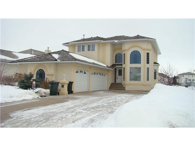 This Custom built 2400+ 5 bedroom fully finished 2 storey with a walk out basement backs onto the lake. Found in a prestigious Nottingham location on a quiet cul-de-sac and steps to Rainbow Junction Park. The interior of this grand home offers granite counter tops found in the kitchen as well as in all the bathrooms. The list continues with stainless steel appliances, newer flooring, 10 ft. ceilings, air conditioning, maintenance free deck off the kitchen nook and master bedroom along with an abundance of windows throughout this home to capture amazing views of your lake setting. Of course, an over sized triple garage to house all those toys you need space for. This is a true family home! The backyard has been professionally landscaped and recently upgraded with another deck for multiple options of where you would like to relax and enjoythe pond/water feature and fire pit, and covered hot tub area.