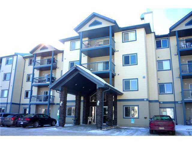 This complex has a lot to offer! As you walk in the main doors you find a well appointed sitting room off to your left, an exercise room on the opposite side, a games room and a guest suite. This unit has TWO PARKING STALLS - one above ground and on in the underground parking for the family with two cars. The suite offers two good sized bedrooms, the master with a four piece ensuite, large living room with patio doors to a private deck that comes with a gas barbeque, CENTRAL AIR CONDITIONING, a galley kitchen and a good sized eating area. Let's not forget the NEW CARPETS throughout as well as in suite laundry/storage room and a storage space in front of your underground parking stall. Close to shopping, banks, restaruants and more.