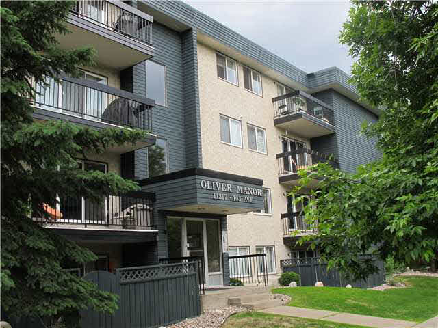 Notice this - over 1000 square foot top floor unit in Oliver Manor - close to downtown and Grant MacEwan. 2 Bedrooms and 1.5 Baths including the 2-piece ensuite. Has in-suite laundry and storage. Hardwood floors in Living room, Dining room and Hallway. Brand new carpet in both Bedrooms. Ceramic tile in kitchen and baths. Good sized kitchen. Huge Living room with plenty of space for open Den area. Mirrored closet doors. Appliances are included. 1 energized ground level parking stall. East facing Balcony for morning Sun and view of downtown. Newer vinyl windows and light fixtures. Freshly painted. Close to many amenities and great transit connections. Quick possession available.