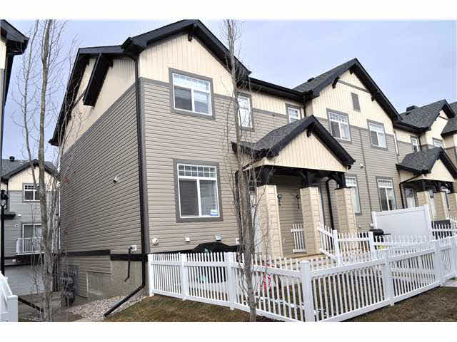 This executive townhouse is built with modern urban living flare. An end unit townhouse in Mosaic Meadows with a floor plan to maximize living space and provide all necessities and more such as a double attached garage that is accessible from the basement. There are 3 bedrooms on the upper level with a 3 pce. ensuite and walk in closet for the master bedroom and a 4 pce. guest bathroom. The main floor features durable laminate throughout with an open concept kitchen, breakfast nook and living room and another 2 pce. bathroom. The kitchen provides surprising space and features stainless steel appliances and a raised eating bar. There is a front yard that has a white picket fence and can fulfil a green thumb, a B.B.Q king and keep kids and puppies busy. The basement provides a laundry room, storage space and garage entrance. The Hamptons is a vibrant neighborhood, everything is new and there is a new k-9 school around the corner. Easy access to the Anthony Henday.
