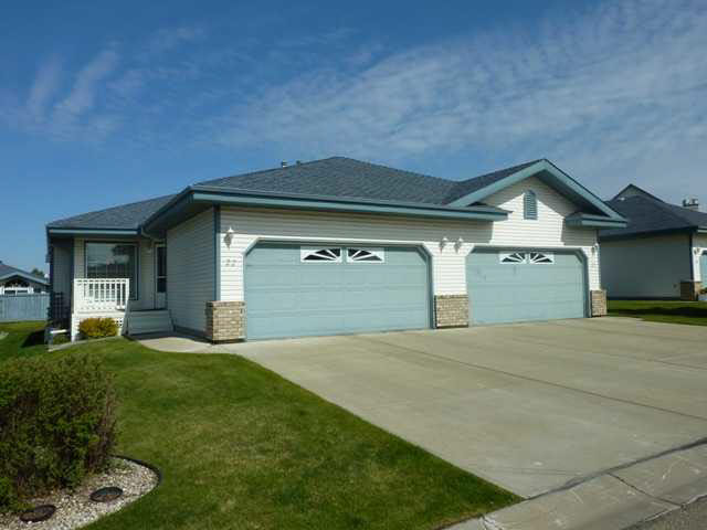 Terra Losa Estates (South) Premier Adult Bungalow Living.Immaculate Condition. 1234 Sq.Ft. 2 +1 Bedroom 3 Bathroom Fully Developed Throughout.Vaulted Ceilings,Open Living Space. Formal Dining Area, Fireplace in Living Room.Bright Kitchen c/w Butlers Buffet,Loads of Cabinets.Patio Doors to Sunny West Facing Deck.Generous Master Suite,c/w Full Ensuite,Double Closets.Central Staircase Leads to Well Developed Bright Basement.2 Sitting Areas,2nd Fireplace,3rd.Bedroom.Full Bathroom,Ample Finished Storage.Full Appliance Package,Central Vac.Double Attached Garage c/w Shelving,Cabinets Complete the Property with Style. .Units Rarely Available in this Highly Sought After Complex,Well Run with a Private Community Feel.Steps to Every Type of Shopping,Medical,Restaurant,Service.Safe,Secure,Protected Private Residence Awaits.