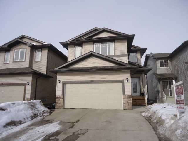 '''LOOKS LIKE BRAND NEW'''A charming and large 2 storey home located in the neighborhood of Silverberry. The buyer will be welcomed with open den, family room, nice and big kitchen with granite counter tops, tile backsplash, and full bath on main floor. Enjoy a huge Master bedroom with full ensuite including a Jacuzzi tub and separate shower. There is a bonus room and 3 more bedrooms upstairs and four pc bathroom on Upper level. The house has cherry hardwood floors, ceramic tiles, upgraded kitchen cabinets, gas stove, stainless steel appliances, a cozy fireplace. The unfinished basement has a separate entrance for relatives or to create a revenue property. Fully landscaped and has huge deck in back. Close to schools, silverberry park, shopping and within easy reach to the Anthony Henday. This home has it ALL at an outstanding value!