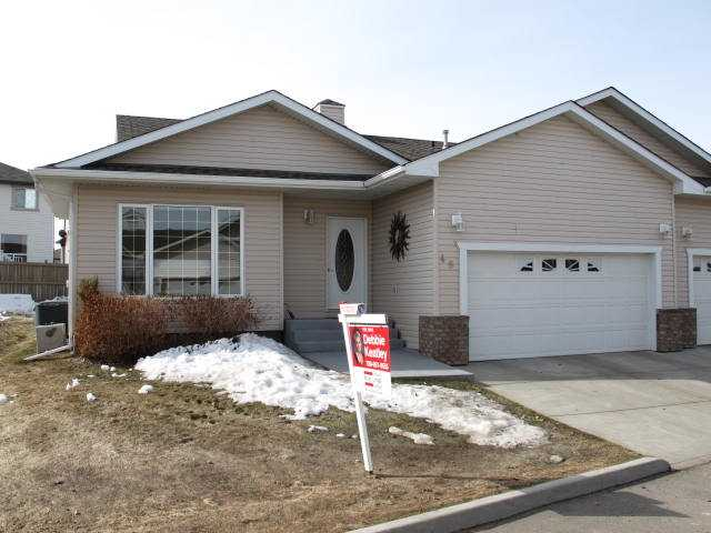 This 1350 sq ft adult living bungalow is located within easy walking distance to all major shopping and public transportation. The home is lovely and bright with large south facing windows and a huge picture window in your 2nd bedroom. The kitchen has loads of cabinets and counter space and a good sized eating nook. There is a walk in pantry and a designer backs plash. The main floor has gleaming hardwood flooring. The laundry room is spacious and on the main floor. The master bedroom will take a king sized suite and has a lovely walk in closet and a 3pc ensuite with double shower. The garage is a full double and heated. The basement is fully developed with a 3 pc bath, large bedroom, den and family room. There is no shortage of storage space. The home has central AC for those hot summer nights. The back deck is large and south facing. The home shows great pride of ownership. For more info visit realtors website.